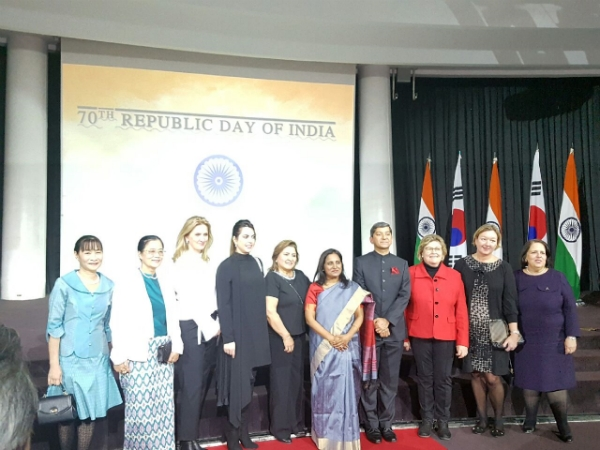 India envoy posing with the spouses of the Ambassadors during its opening ceremony.